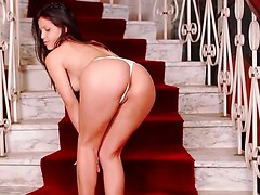 A staircase is the perfect opportunity for Sarah Delgado to showcase her firm ass in its thong and her small boobs tipped with big areolas and puckered nipples. Settling down with her thighs spread, she slips a hand between her legs to fondle her clit an